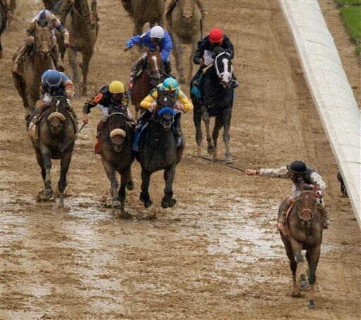 In this May 2, 2009, photo, Calvin Borel rides Mine That Bird to victory during the Kentucky Derby horse race at Churchill Downs in Louisville, Ky.