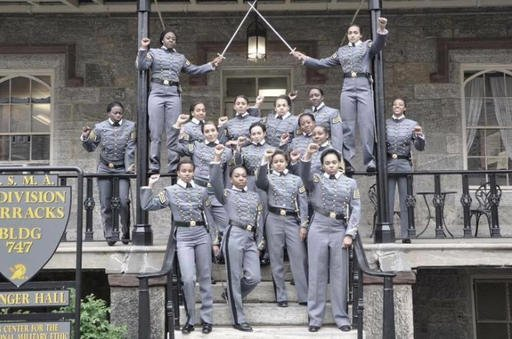 This undated image taken from Twitter shows 16 black, female cadets in uniform with their fists raised while posing for a photograph at the United States Military Academy at West Point, N.Y.