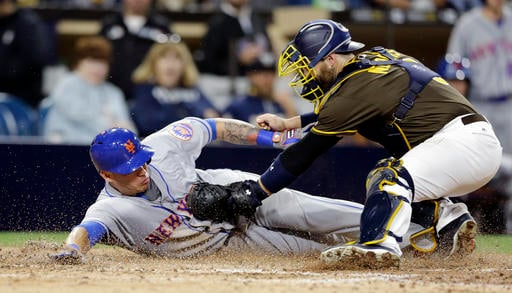 San Diego Padres catcher Derek Norris, right, tags out New York Mets' Asdrubal Cabrera during the seventh inning of a baseball game Friday, May 6, 2016, in San Diego.
