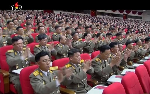 In this image made from video by North Korean broadcaster KRT, military officers applaud as North Korean leader Kim Jong Un gives speech at the party congress in Pyongyang, North Korea, Saturday, May 7, 2016. North Korea will not use its nuclear weapons f