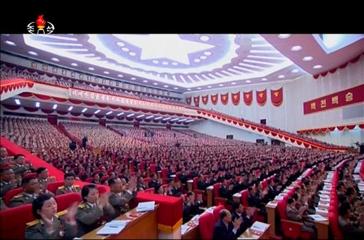 In this image made from video by North Korean broadcaster KRT, military officers and delagates applaud as North Korean leader Kim Jong Un gives speech at the party congress in Pyongyang, North Korea, Saturday, May 7, 2016. North Korea will not use its nuc