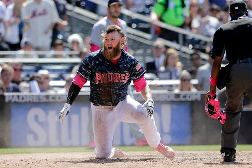 San Diego Padres' Andrew Cashner reacts after being called out at home during the fifth inning of a baseball game against the New York Mets, Sunday, May 8, 2016, in San Diego. (AP Photo/Gregory Bull)