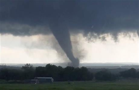 "A broad tornado capable of leaving ""catastrophic"" damage in its wake churned across the Oklahoma landscape Monday, prompting forecasters to declare a tornado emergency for two communities directly in its path. (Hayden Mahan via AP)"