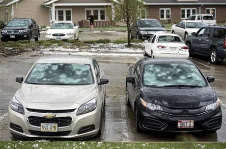 The National Weather Service says a tornado briefly touched down on the southeast edge of Lincoln, Neb., and there were reports of baseball-sized hail is falling in the area. (Kristin Stref/The Journal-Star via AP)