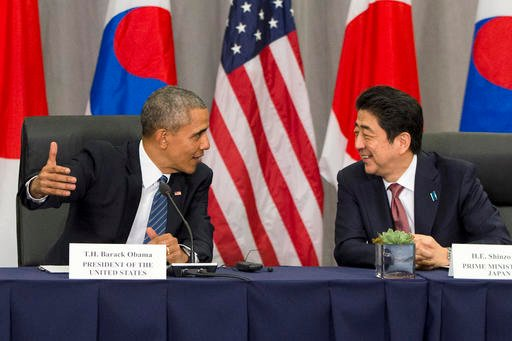 In this March 31, 2016, file photo, U.S. President Barack Obama speaks with Japanese Prime Minister Shinzo Abe during their meeting at the Nuclear Security Summit in Washington.