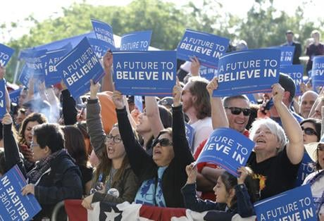 Supporters of Democratic presidential candidate, Sen. Bernie Sanders, I-Vt., wave signs before a campaign rally, Tuesday, May 10, 2016, in Stockton, Calif.(AP Photo/Rich Pedroncelli)