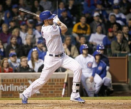 Chicago Cubs' Kris Bryant follows through on a two-run double off San Diego Padres starting pitcher Cesar Vargas during the third inning of a baseball game Tuesday, May 10, 2016, in Chicago. (AP Photo/Charles Rex Arbogast)