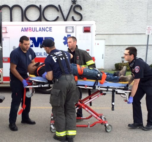 The suspect in attacks at Silver City Galleria mall is transported on a gurney into an ambulance by medical personnel in Taunton, Mass., Tuesday, May 10, 2016.