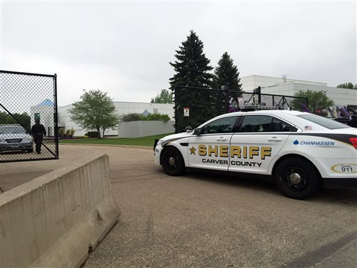 A Carver County sheriff's vehicle enters through the gates of Prince's Paisley Park home and studio in Chanhassen, Minn., Tuesday, May 10, 2016.