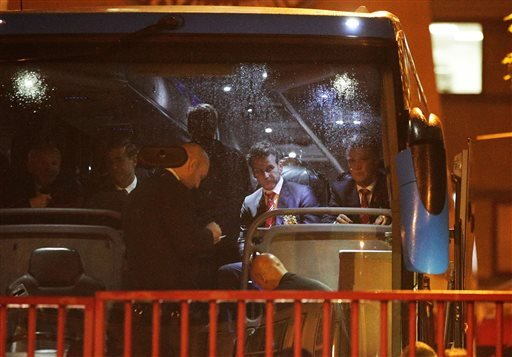 Manchester United manager Louis van Gaal, right, waits on board a new coach as the team prepare to leave Upton Park, London, Tuesday May 10, 2016.