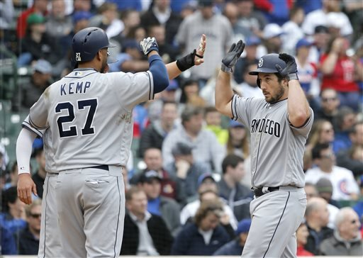 San Diego Padres' Brett Wallace, right, is greeted at home by Wil Myers and Matt Kemp (27) after the trio scored on Wallace's three-run home run off Chicago Cubs relief pitcher Pedro Strop.