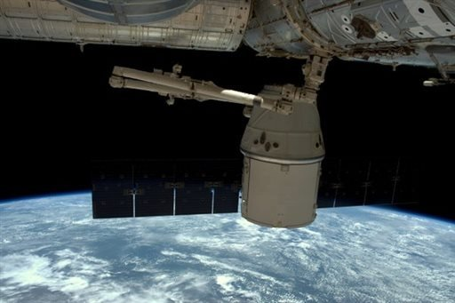 This photo released by NASA, shows the SpaceX Dragon undocked from the International Space Station as it is maneuvered for its release, Wednesday, May 11, 2016. The SpaceX capsule is headed back to Earth with precious science samples from NASA's one-year