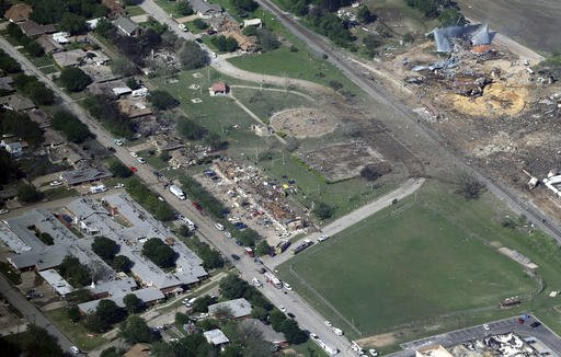 This April 18, 2013 aerial file photo shows the remains of a nursing home, left, apartment complex, center, and fertilizer plant, right, destroyed by an explosion at a fertilizer plant in West, Texas. Federal authorities announced Wednesday, May 11, 2016,
