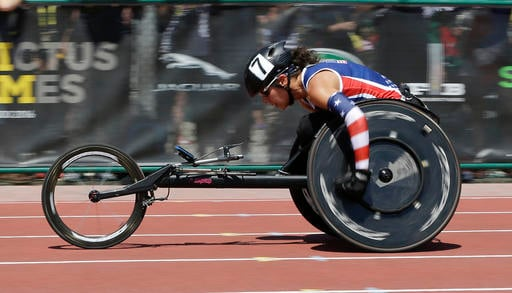 Kelly Elmlinger heads to the finish line to win the women's 200 meter IT4 and IT5 combined race at the Invictus Games, Tuesday, May 10, 2016, in Kissimmee, Fla. (AP Photo/John Raoux)