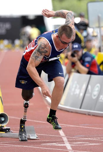 Allan Armstrong comes out of the starting block during the men's 400 meter IT2 race at the Invictus Games, Tuesday, May 10, 2016, in Kissimmee, Fla. (AP Photo/John Raoux)