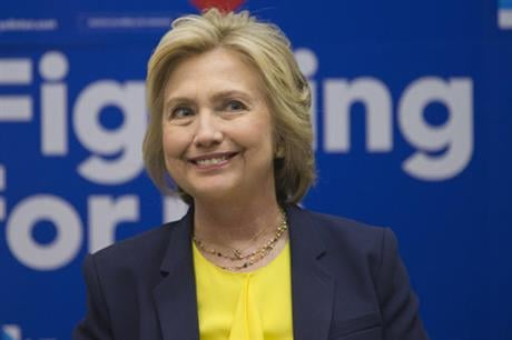 Democratic presidential candidate Hillary Clinton participates in a round table discussion with HIV/AIDS activists, Thursday, May 12, 2016, at he campaign headquarters in New York. (AP Photo/Mary Altaffer)