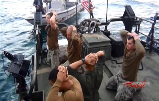 This frame grab from Tuesday, January 12, 2016 video by the Iranian state-run IRIB News Agency, shows detention of American Navy sailors by the Iranian Revolutionary Guards in the Persian Gulf, Iran.