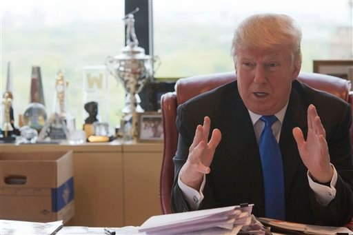In this Tuesday, May 10, 2016 file photo, Republican presidential candidate Donald Trump gestures as he speaks during an interview with The Associated Press in his office at Trump Tower, in New York.