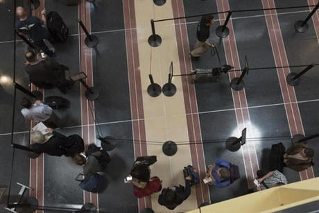 Fliers across the country have been facing growing lines, which during peak hours have topped 90 minutes at some airports. The TSA has fewer screeners and has tightened security procedures. Meanwhile, more people are flying. (AP Photo/Sait Serkan Gurbuz)