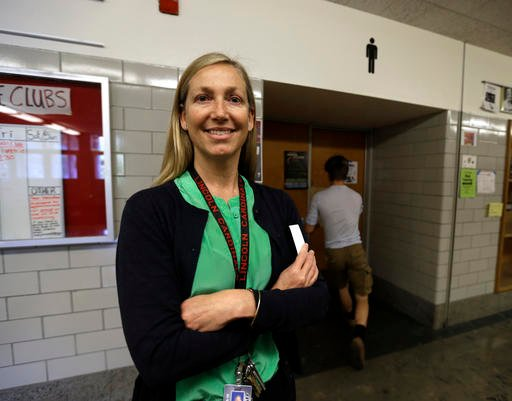 In this photo taken May 13, 2016, Lincoln High School principal Peyton Chapman poses for a photo in the halls of the school in Portland, Ore., Friday, May 13, 2016.