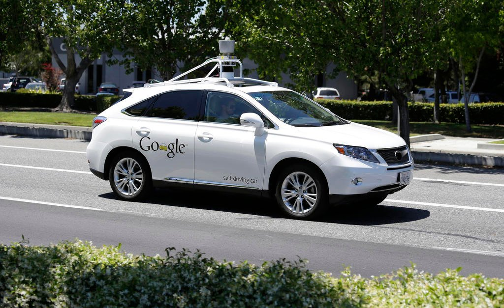 In this May 13, 2014 file photo, a Google self-driving car goes on a test drive near the Computer History Museum in Mountain View, Calif. Self-driving cars are expected to usher in a new era of mobility, safety and convenience. The problem, say transporta