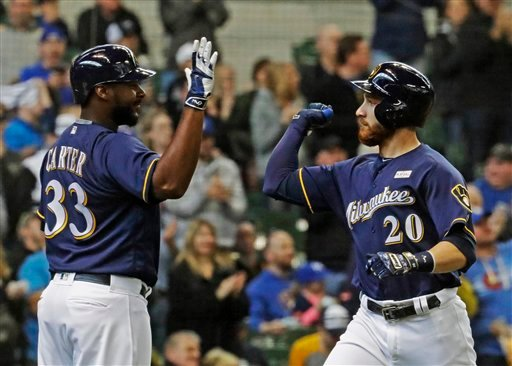 Milwaukee Brewers' Jonathan Lucroy (20) is congratulated by Chris Carter (33) after hitting a home run during the fifth inning of a baseball game against the San Diego Padres Sunday, May 15, 2016, in Milwaukee. (AP Photo/Morry Gash)