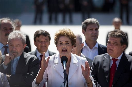 In this May 12, 2016, file photo, Brazil's President Dilma Rousseff speaks after leaving Planalto presidential palace in Brasilia, Brazil, after the Senate voted to suspend her pending an impeachment trial. Rousseff is living in the presidential residence