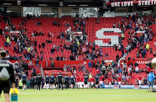 Fans leave the stands after a security announcement during the English Premier League match at Old Trafford, Manchester, England. Sunday May 15, 2016. Manchester United's final game of the season against AFC Bournemouth at Old Trafford has been abandoned.