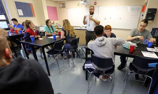 In this May 5, 2016 photo, Manhattan High School science teacher Noah Busch instructs his class before setting up mosquito traps around the school in Manhattan, KS. The mosquitoes that can spread the disease Zika are already buzzing in places around the U
