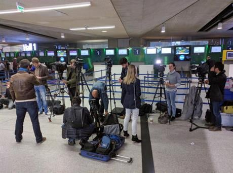 Reporters gather in front of the EgyptAir counter at Charles de Gaulle Airport outside of Paris on Thursday, May 19, 2016. An EgyptAir flight from Paris to Cairo carrying 66 people disappeared from radar early Thursday morning, the airline said. (AP Photo