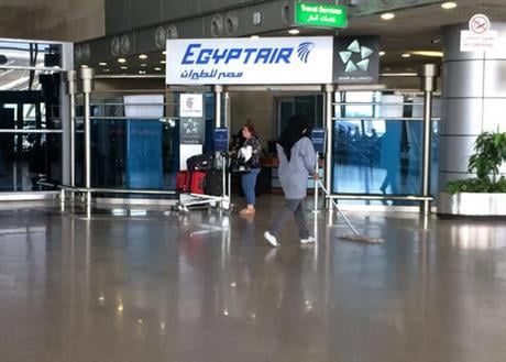 The Egyptair logo is seen at the arrivals section of Cairo International Airport, Egypt, Thursday, May 19, 2016. An EgyptAir flight from Paris to Cairo carrying 66 people disappeared from radar early Thursday morning, the airline said. (AP Photo/Amr Nabil