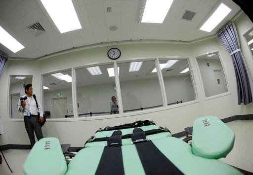 In this Sept. 21, 2010 file photo, the view a condemned inmate would have from a table inside the death chamber is shown during a tour of the new lethal injection facility at San Quentin State Prison in San Quentin, Calif.