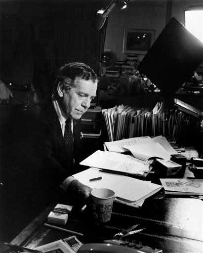 This 1985 photo released by CBS shows Morley Safer at his office in New York.