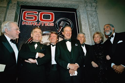 "In this Nov. 10, 1993 file photo, The ""60 Minutes"" team, from left, Andy Rooney, Morley Safer, Steve Kroft, Mike Wallace, executive producer Don Hewitt, Lesley Stahl, and Ed Bradley pose at the Metropolitan Museum of Art in New York."