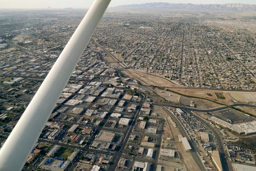 This May 1, 2015 photo shows an aerial view of the US Mexico border showing Calexico, Calif. below and Mexicali, Mexico above.