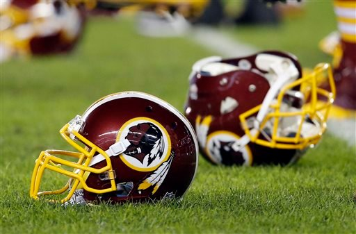 In this Dec. 26, 2015, file photo, a Washington Redskins helmet sits on the field as players warm-up before an NFL football game against the Philadelphia Eagles in Philadelphia.