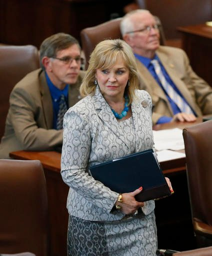Oklahoma Gov. Mary Fallin walks on the floor of the Oklahoma House in Oklahoma City. Gov. Fallin has vetoed legislation that would make it a felony for doctors to perform an abortion, a measure that would have effectively outlawed the procedure in the sta