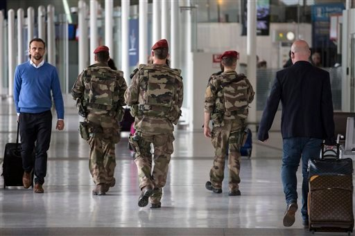 French soldiers patrol at Charles de Gaulle airport, outside of Paris, Friday, May 20, 2016.