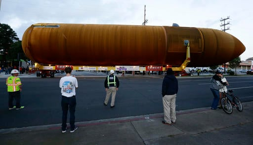 The space shuttle external propellant tank is moved through the streets of Los Angeles on Saturday, May 21, 2016.