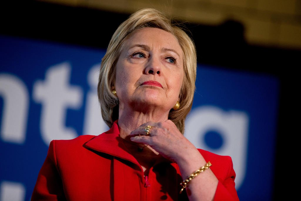 In this May 16, 2016 photo, Democratic presidential candidate Hillary Clinton waits to speak at a get out the vote event at La Gala in Bowling Green, Ky. Hillary Clinton has a message for Donald Trump: Bring it on. As Clinton's path to the Democratic nomi