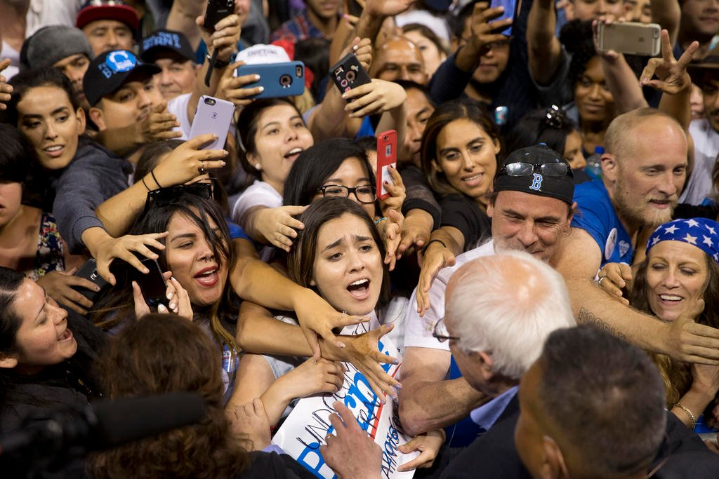 In this May 17, 2016 file photo, Democratic presidential candidate Sen. Bernie Sanders, I-Vt., greets supporters after speaking at a rally in Carson, Calif. Bernie Sanders' campaign is mining deep into voter data from Hispanic enclaves, scouting for hidde