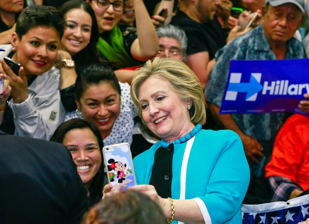 In this May 5, 2016 file photo, Democratic presidential candidate Hillary Clinton takes a photo with supporters at the end of a campaign stop at East Los Angeles College in Los Angeles. Bernie Sanders' campaign is mining deep into voter data from Hispanic