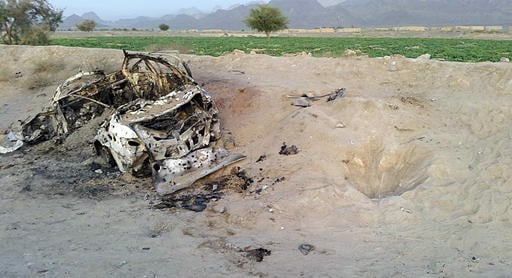 This photo taken by a freelance photographer Abdul Salam Khan using his smart phone on Sunday, May 22, 2016, purports to show the destroyed vehicle in which Mullah Mohammad Akhtar Mansour was traveling in the Ahmad Wal area in Baluchistan province of Paki