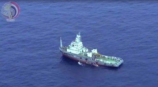 This still image taken from video posted Saturday, May 21, 2016, on the official Facebook page of the Egyptian Armed Forces spokesman shows an Egyptian ship collecting wreckage of EgyptAir flight 804. Smoke was detected in multiple places on EgyptAir flig