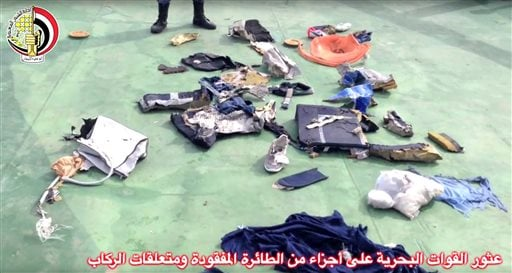 This still image taken from video posted Saturday, May 21, 2016, on the official Facebook page of the Egyptian Armed Forces spokesman shows personal belongings and other wreckage of EgyptAir flight 804. Smoke was detected in multiple places on EgyptAir fl