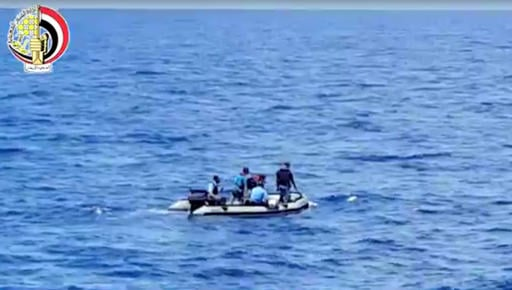 This still image taken from video posted Saturday, May 21, 2016, on the official Facebook page of the Egyptian Armed Forces spokesman shows an Egyptian dinghy collecting wreckage of EgyptAir flight 804. Smoke was detected in multiple places on EgyptAir fl