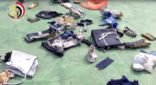 This still image taken from video posted Saturday, May 21, 2016, on the official Facebook page of the Egyptian Armed Forces spokesman shows some personal belongings and other wreckage from EgyptAir flight 804. Smoke was detected in multiple places on Egyp