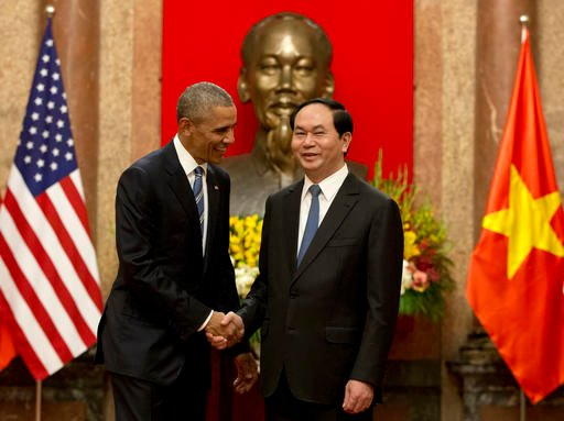 U.S. President Barack Obama, left, and Vietnamese President Tran Dai Quang shake hands at the Presidential Palace in Hanoi, Vietnam, Monday, May 23, 2016. The president is on a weeklong trip to Asia as part of his effort to pay more attention to the regio