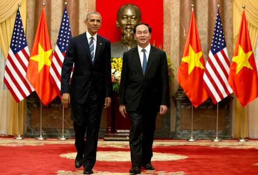 U.S. President Barack Obama, left, and Vietnamese President Tran Dai Quang walk to a meeting after shaking hands at the Presidential Palace in Hanoi, Vietnam, Monday, May 23, 2016. The president is on a weeklong trip to Asia as part of his effort to pay m
