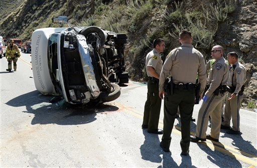 People were injured after a small tour bus crashed and rolled over on highway 330 approximately 2 miles north of the 210 freeway Sunday, May 22, 2016. Both directions of the 330 are currently closed. Cause of the crash is under investigation. (Will Lester